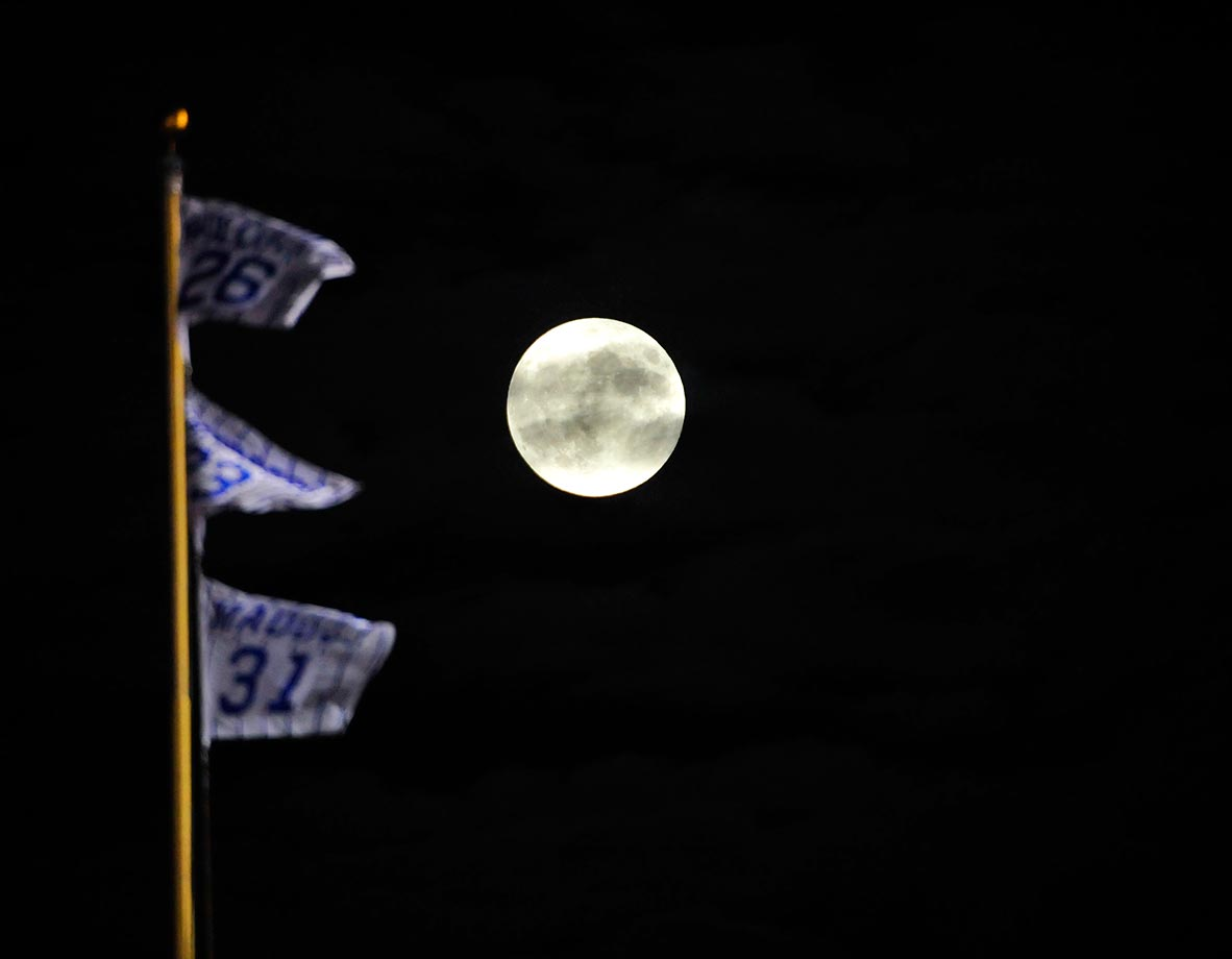 The supermoon (seen before the lunar eclipse) appears to be fair for a home run at the Cubs versus Pirates game.