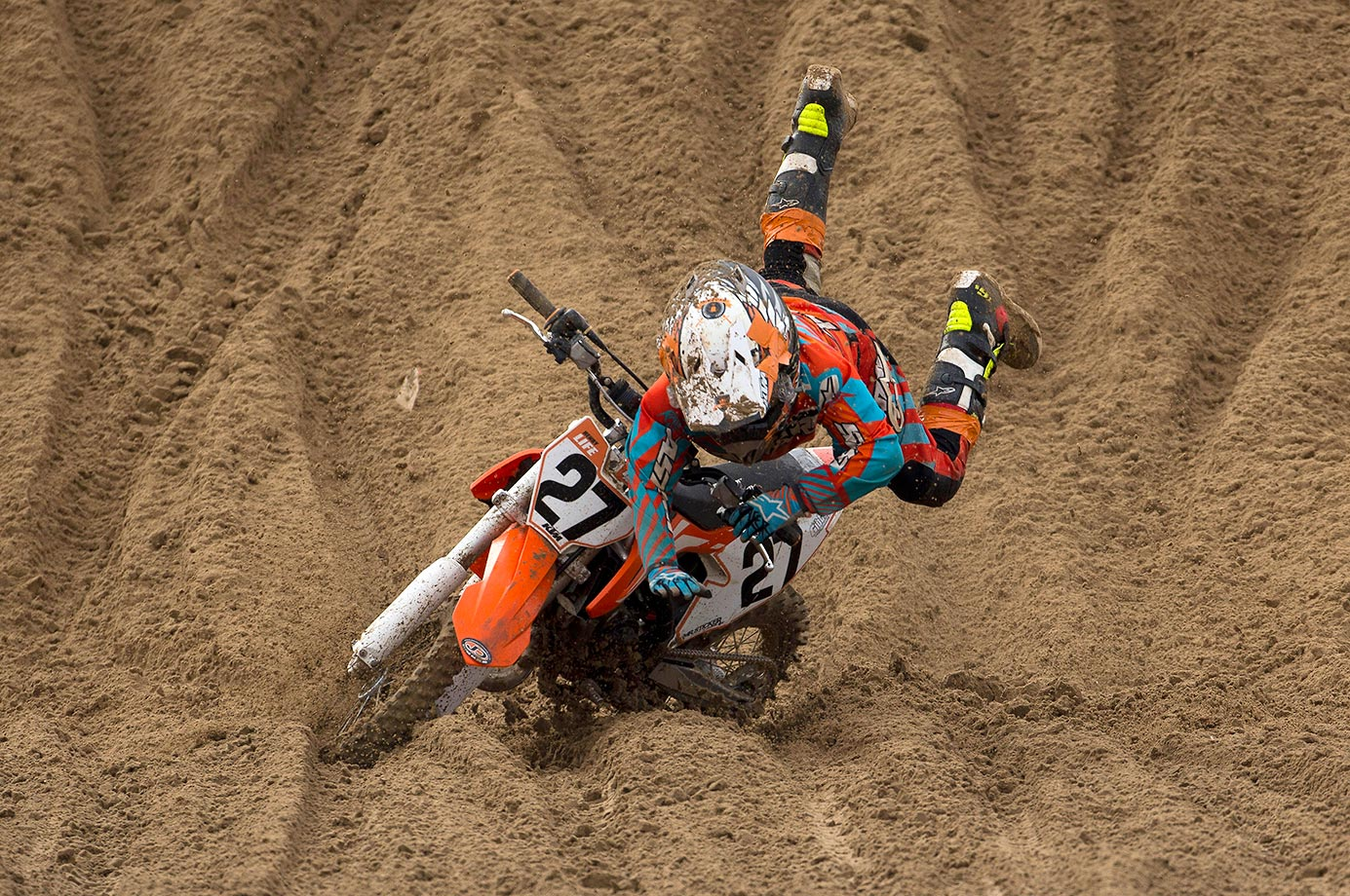 A rider in the Junior 65CC Class falls during the RHL Weston Beach Race in England.