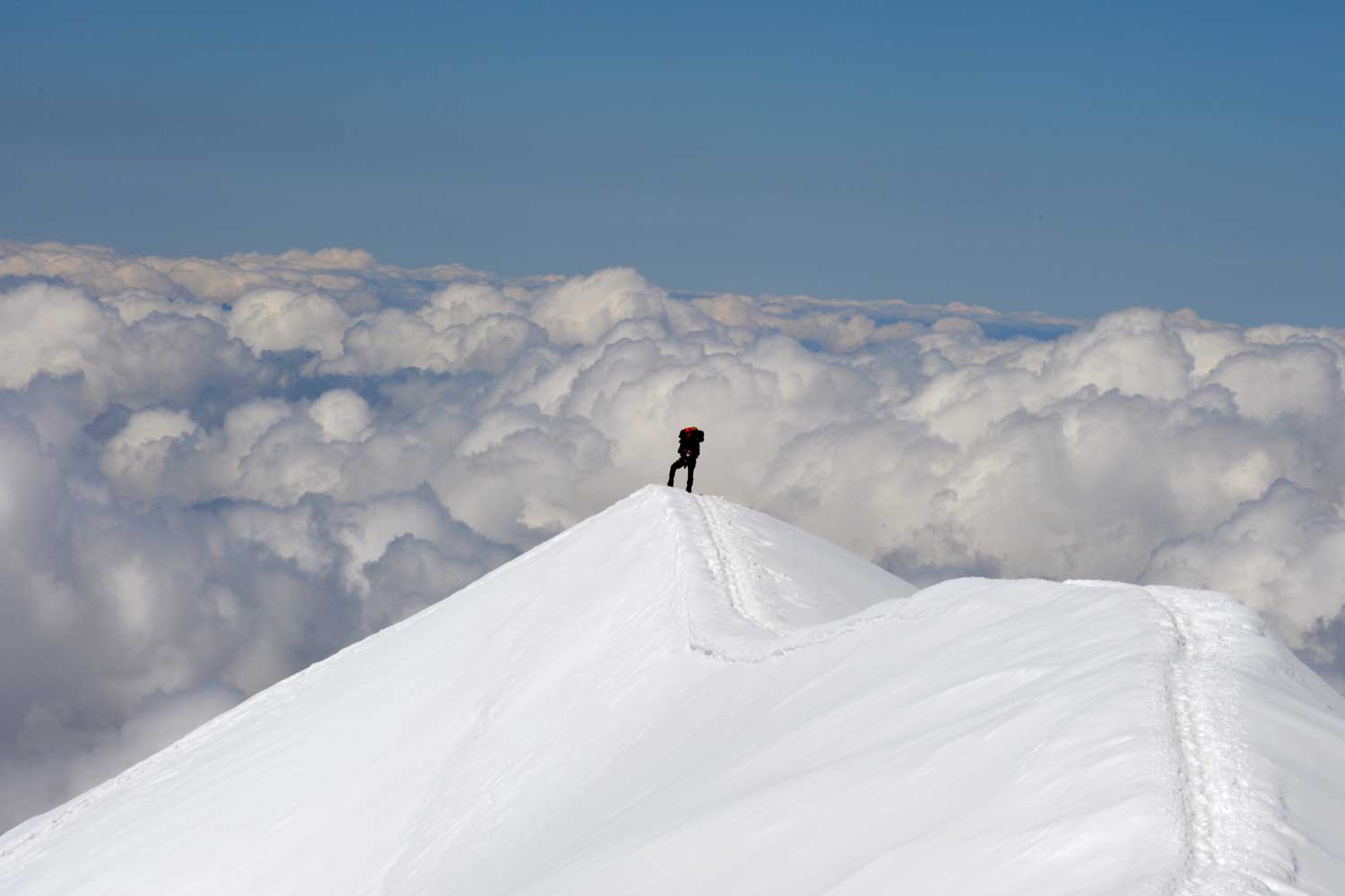 Climbing up the 'Voie royale' to the top of the Dome du Goûter in the French Alps.