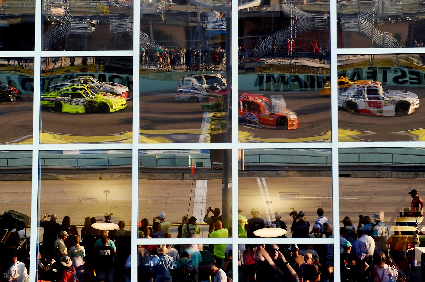 Reflection of cars during the NASCAR Nationwide Series Ford EcoBoost 300 at Homestead-Miami Speedway.
