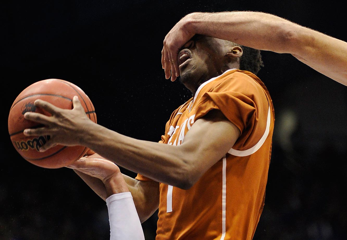 Isaiah Taylor of Texas is fouled during a game against the Kansas Jayhawks.  Kansas won 69-64.