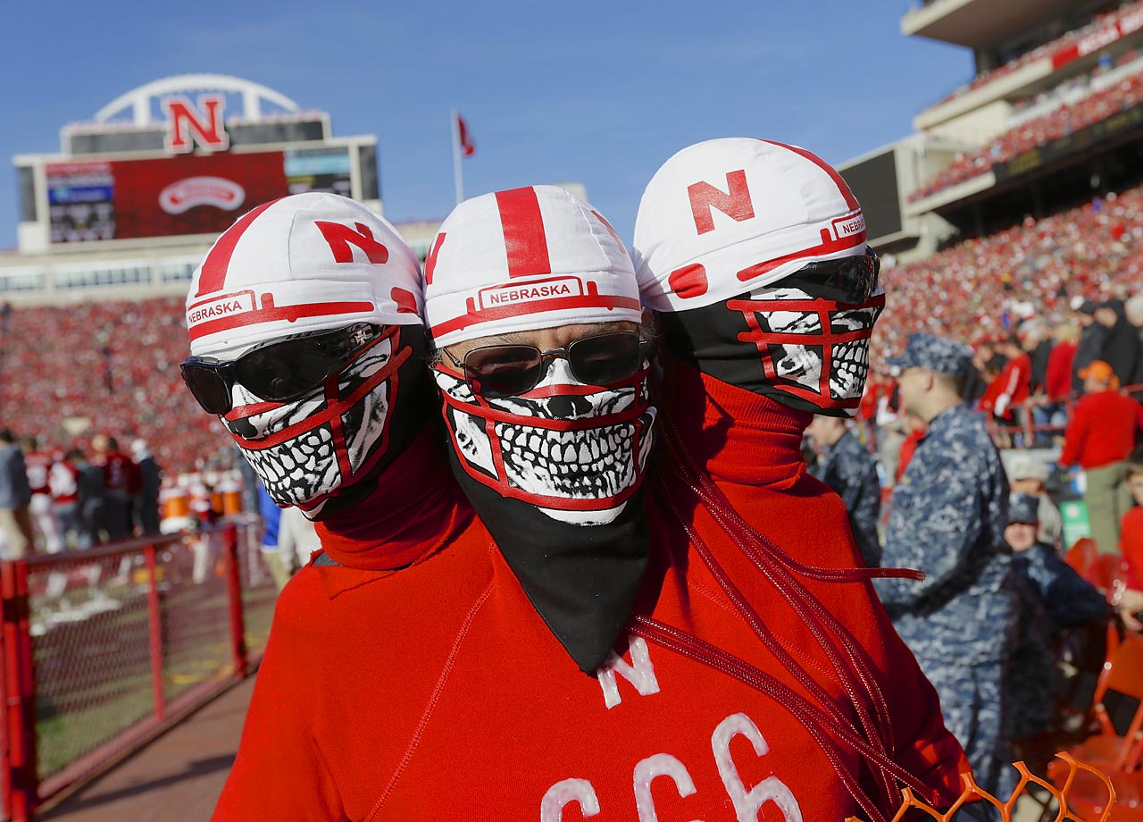 Nebraska fan with extra heads at their team's game against Purdue.