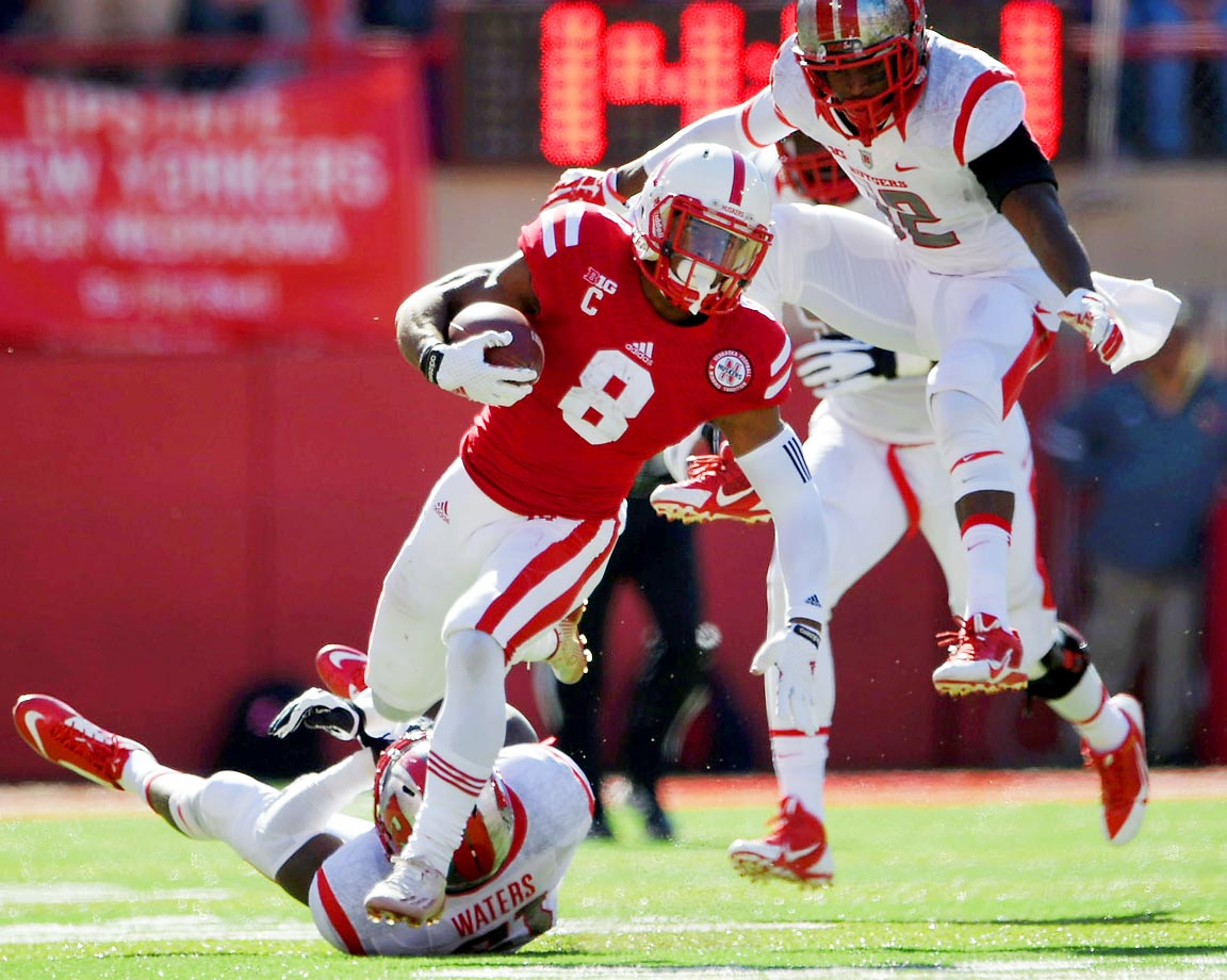 Ameer Abdullah of Nebraska escapes a tackle during his team's 42-24 win over Rutgers.