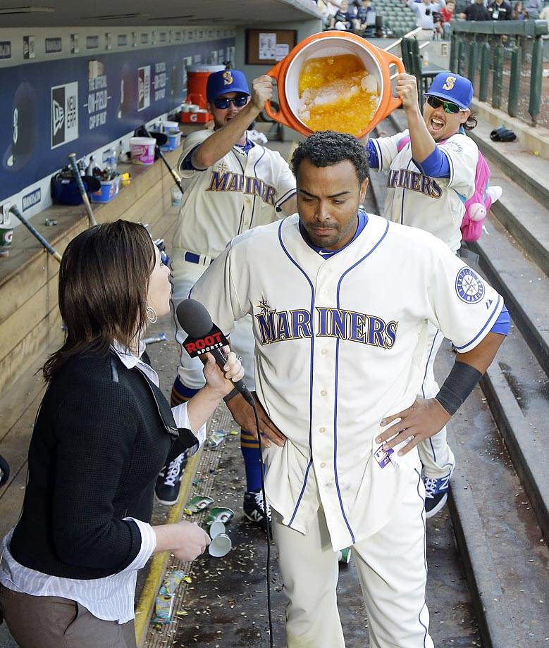 Nelson Cruz of the Mariners is about to get dumped on by Charlie Furbush and Danny Farquhar.