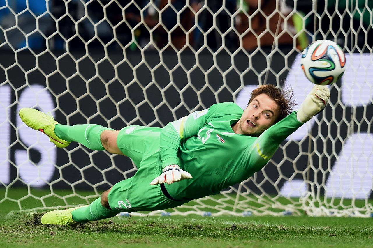 After coming on solely for the PK shootout, Netherlands backup goalkeeper Tim Krul makes one of his two saves against Costa Rica to play hero in the quarterfinals.