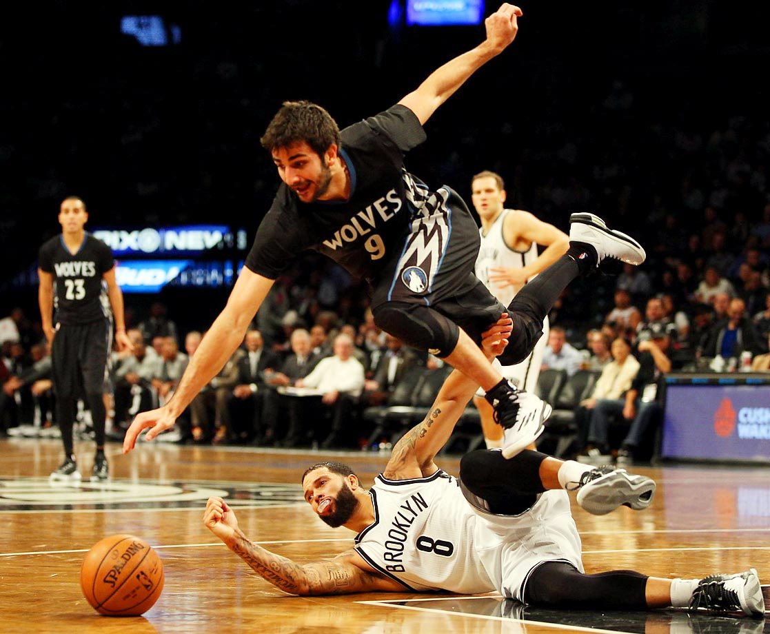 The Minnesota Timberwolves' Ricky Rubio gets caught up with the Brooklyn Nets' Deron Williams while going for the ball. The Timberwolves won 98-91 at the Barclays Center.