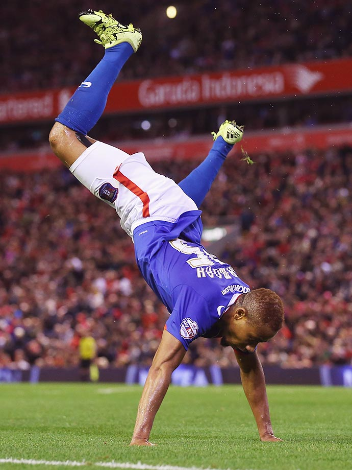 Derek Asamoah of Carlisle United is overjoyed after scoring a goal during the Capital One Cup against Liverpool.