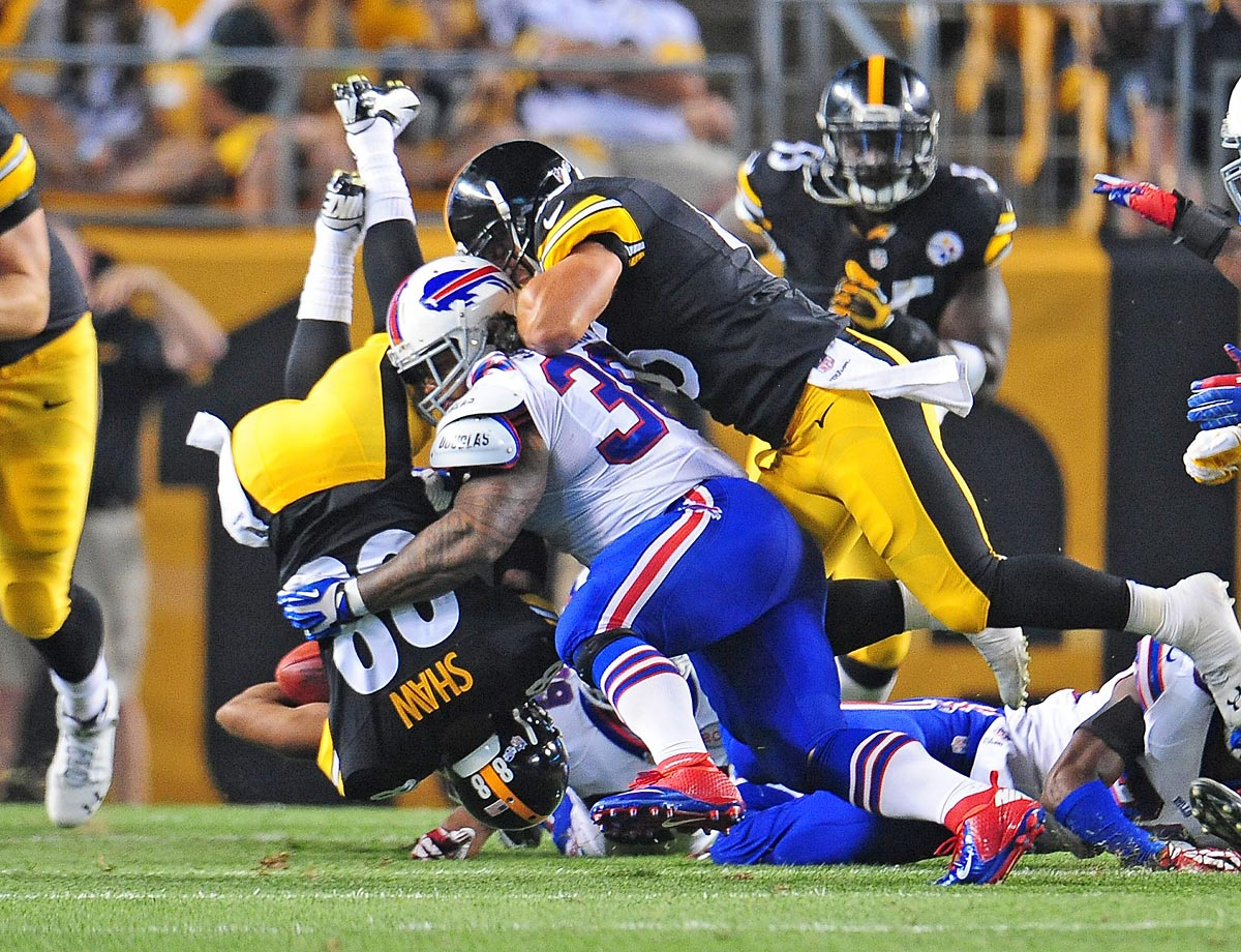 Pittsburgh Steelers running back James Shaw gets flipped during a kickoff return against the Buffalo Bills.