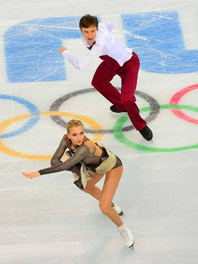 Victoria Sinitsina and Ruslan Zhaganshin  of Russia compete in the short program portion of pairs figure skating.