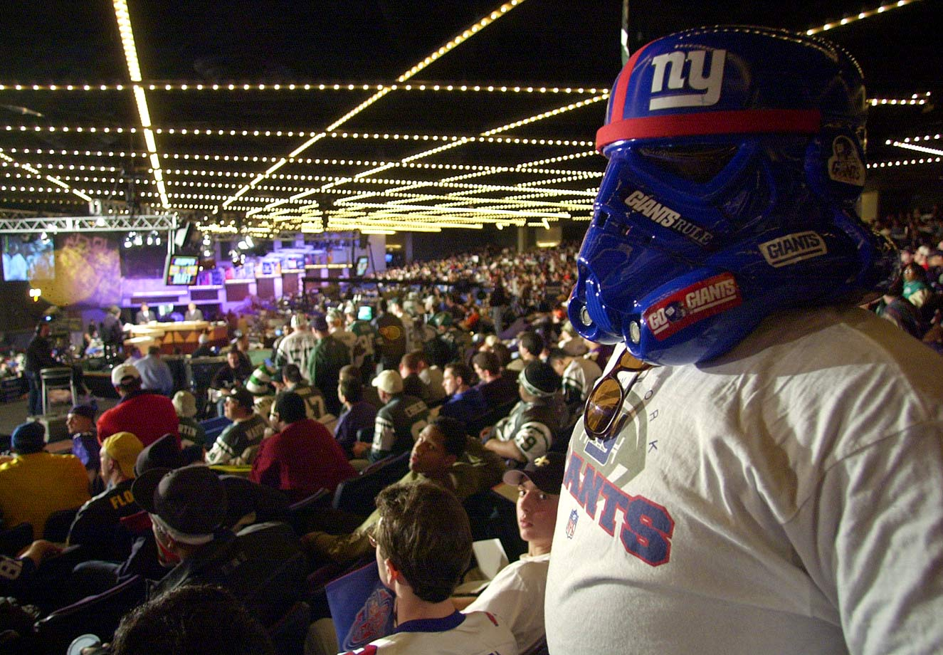 A New York Giants fan looks out at the other fans with his stormtrooper mask during the NFL Draft on April 21, 2001 at Madison Square Garden in New York City.