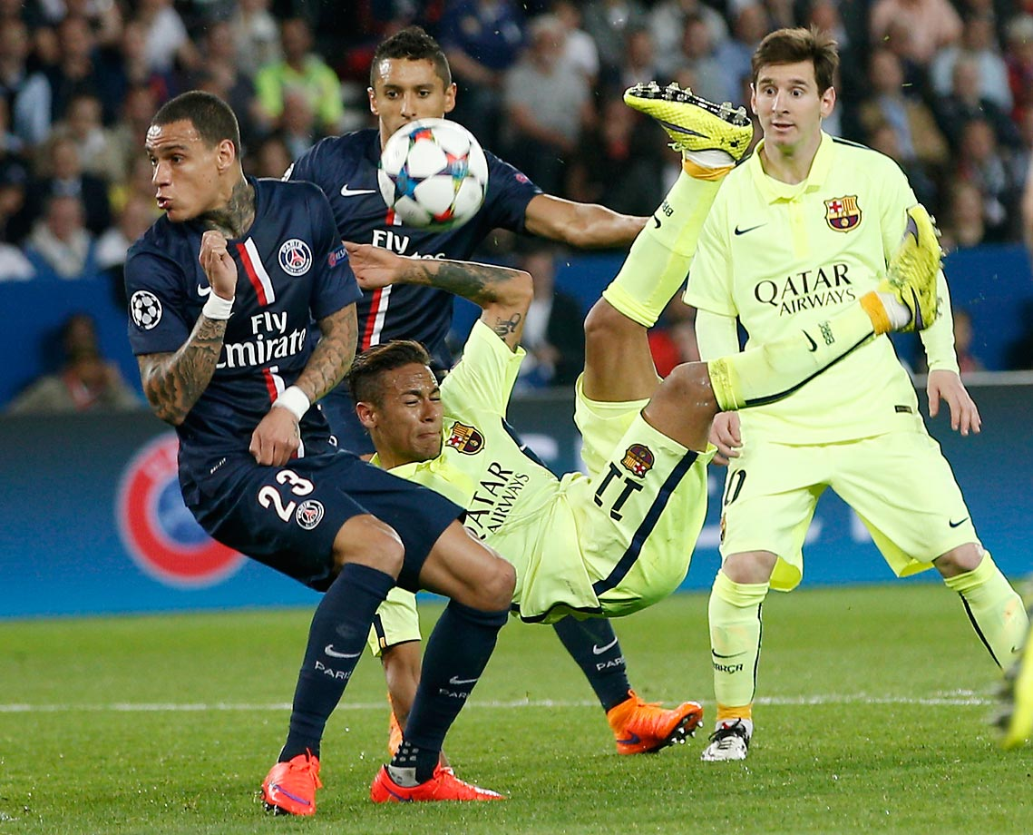 Neymar of Barcelona attempts an overhead kick with teammate Lionel Messi (right) looking on.