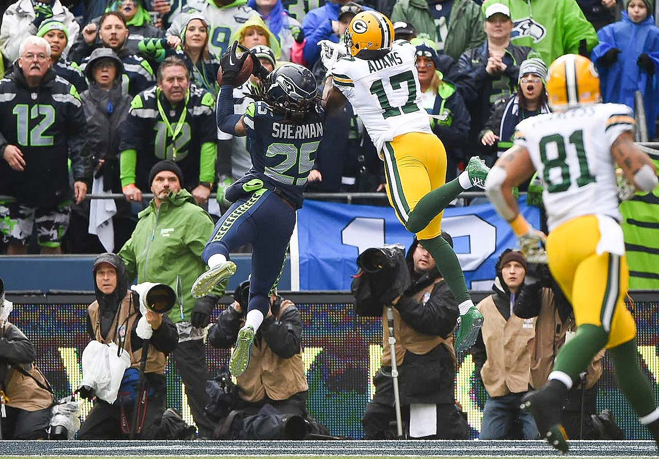 Richard Sherman intercepts a pass intended for Davante Adams.