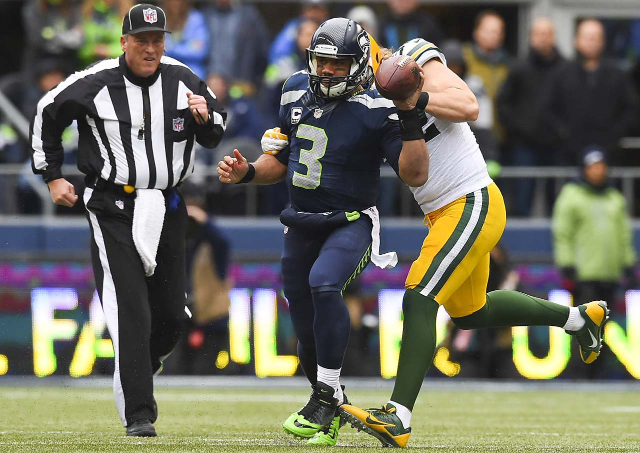 Russell Wilson completed 14 of 29 passes for 209 yards and ran the ball seven times for 25 yards, including a one-yard score to close the gap to 19-14.
