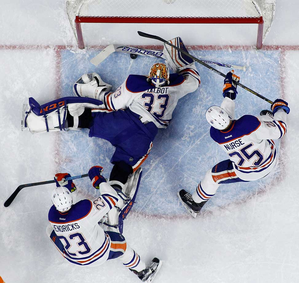 Edmonton's Cam Talbot blocks a shot as teammates Matt Hendricks and Darnell Nurse also defend against Philadelphia in a 2016 game.