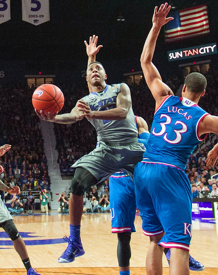 Nigel Johnson (23) of Kansas State drives to the basket late in a game against the Kansas Jayhawks