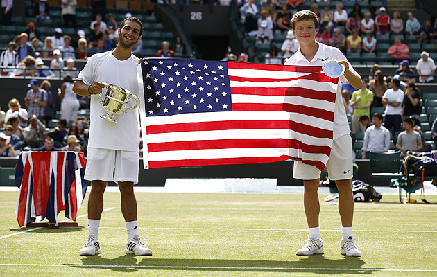 Noah Rubin (left) and Stefan Kozlov pose with the American flag after Rubin beat Kozlov in the Wimbledon boys' final this year.