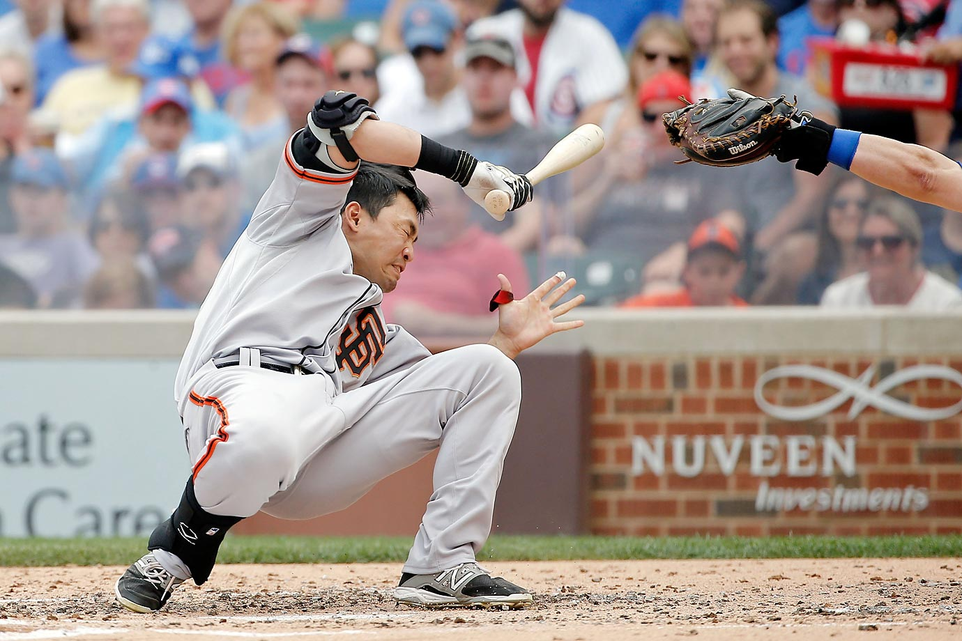 Nori Aoki of the San Francisco Giants is hit in the head by a pitch thrown by Jake Arrieta of the Chicago Cubs.