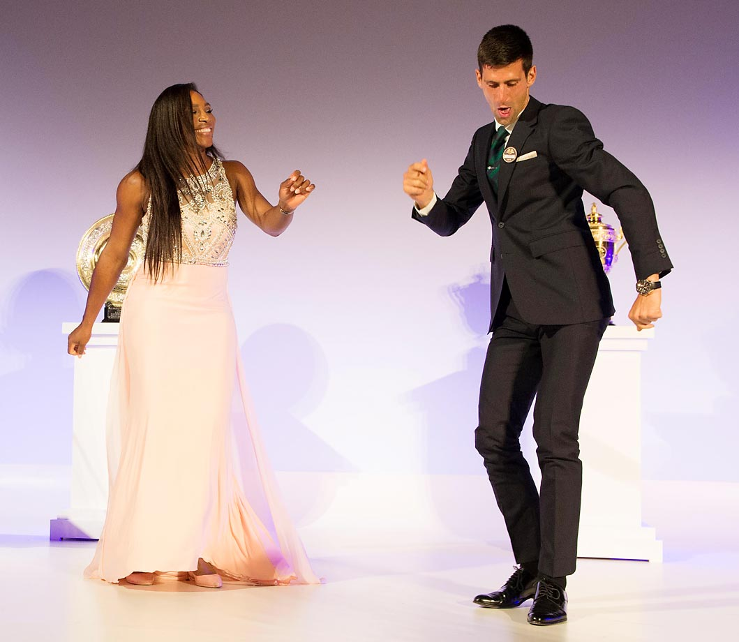 Serena Williams and Novak Djokovic dance on stage at the Champions Dinner at Wimbledon.