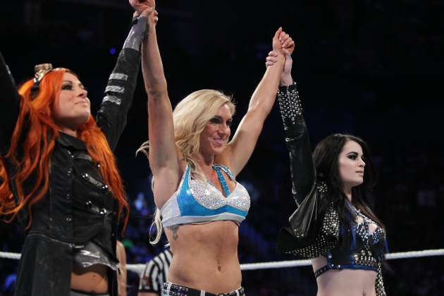 NXT wrestlers (L to R) Becky Lynch and Charlotte with WWE's Paige
