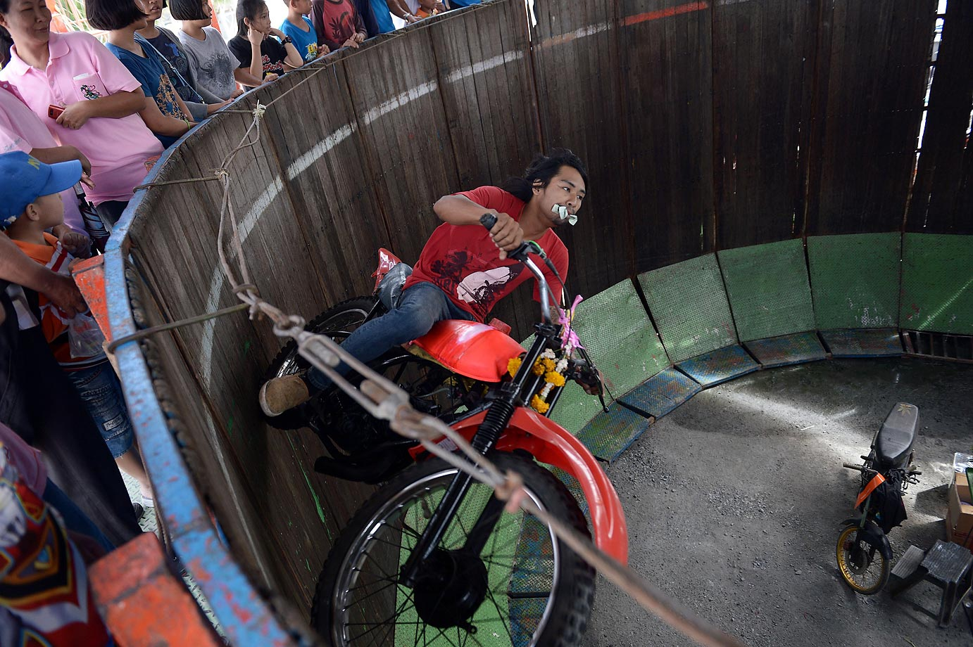 Motorcycling in a cylinder during the annual buffalo races in Chonburi.