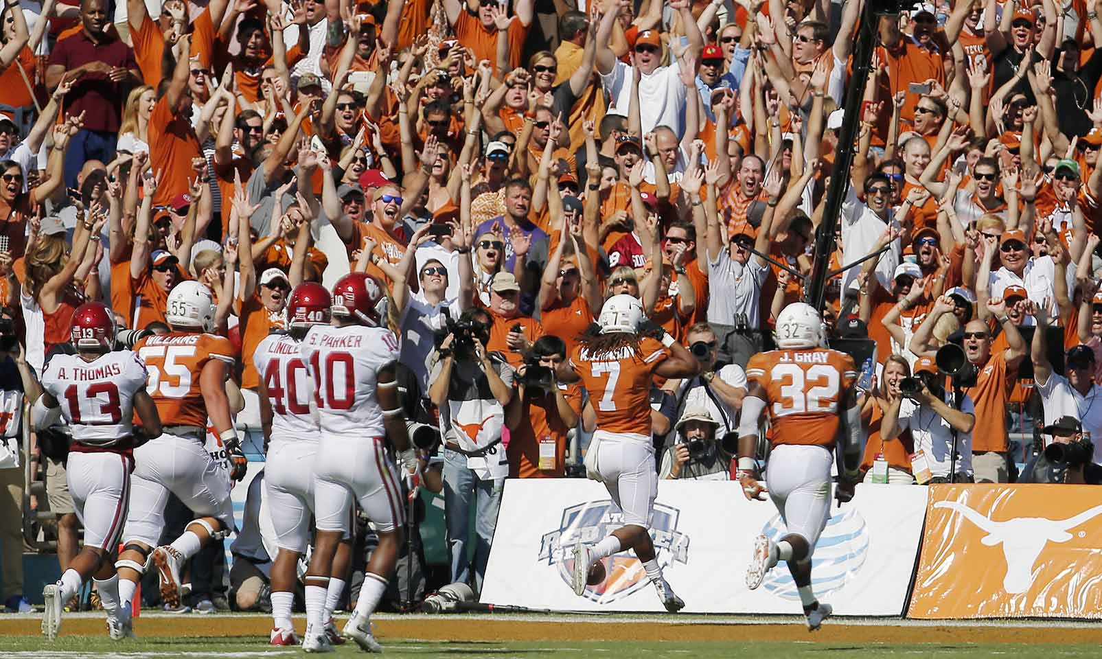 Texas 24, Oklahoma 17: The Longhorns stunned the Sooners in the Red River Rivalry, capitalizing on sloppy tackling to rush for 313 yards. Oklahoma's own ground game got nothing going, gaining just 1.8 yards per carry.