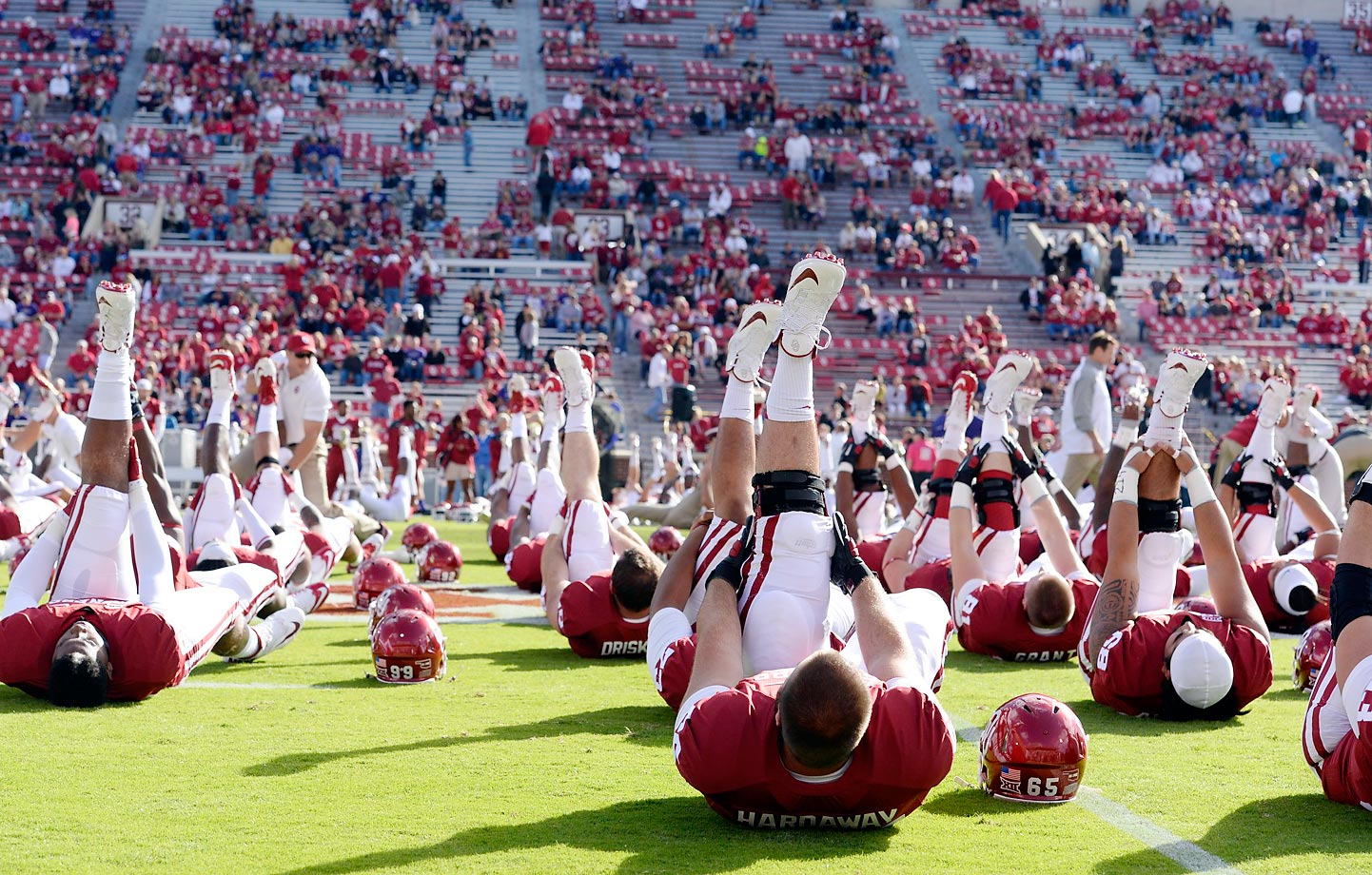Oklahoma players stretch prior to their game against Kansas State.