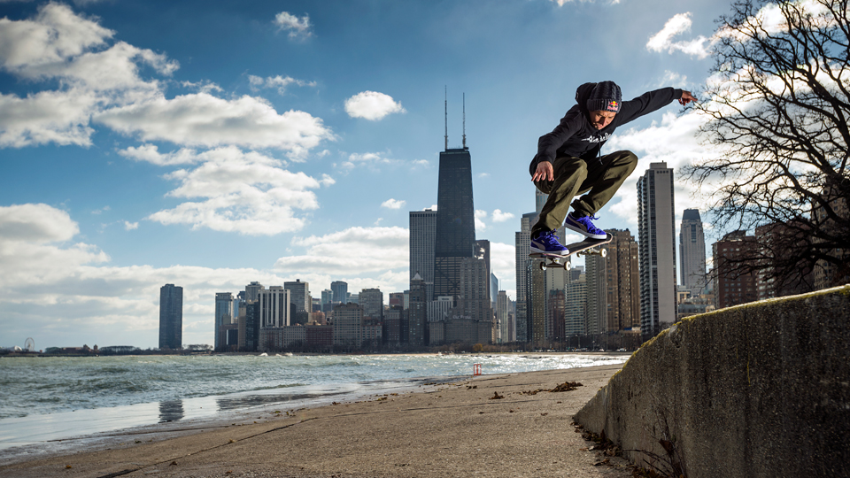"Well known for his ""manual tricks,"" Joey Brazinski, an American street skateboarder, performs an ollie in front of the Chicago skyline."