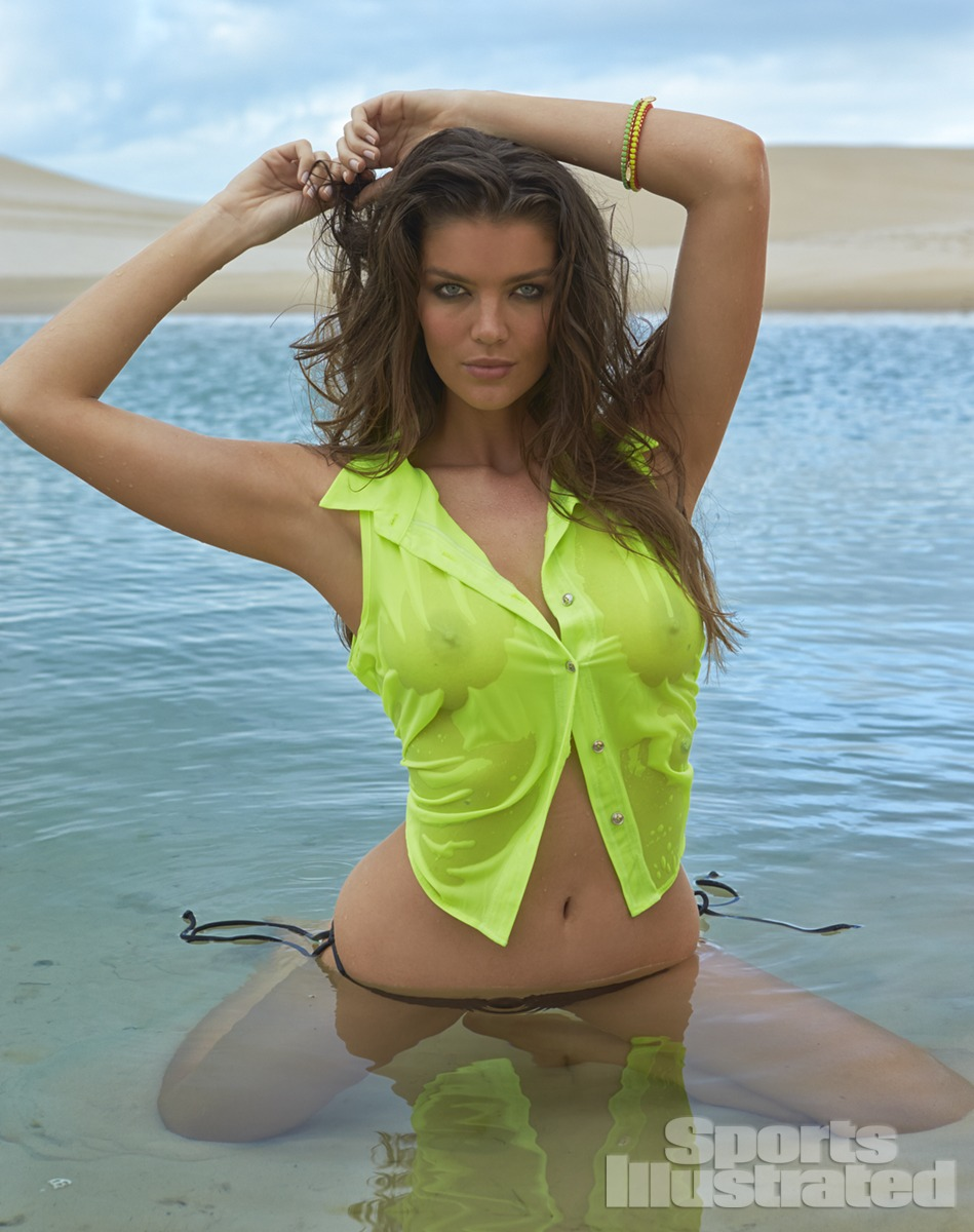 Natasha Barnard was photographed by Raphael Mazzucco in Brazil. Swimsuit by Mikoh, top by Celine by Champion.