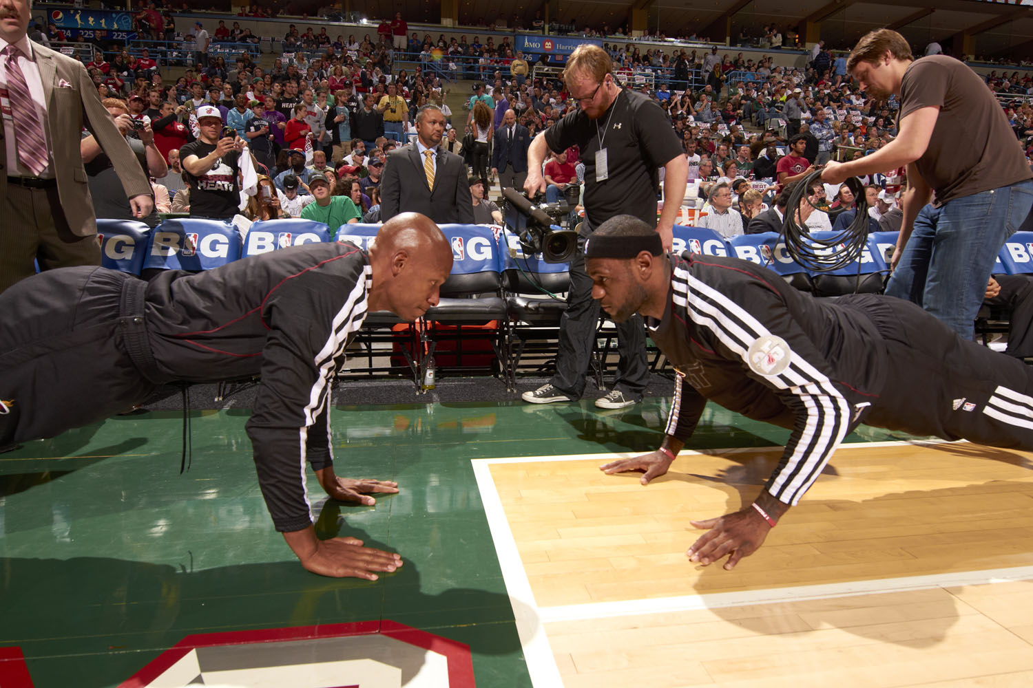 The Miami Heat's LeBron James (R) stretching with Ray Allen (L) before a game against the Milwaukee Bucks at the Bradley Center in 2013.