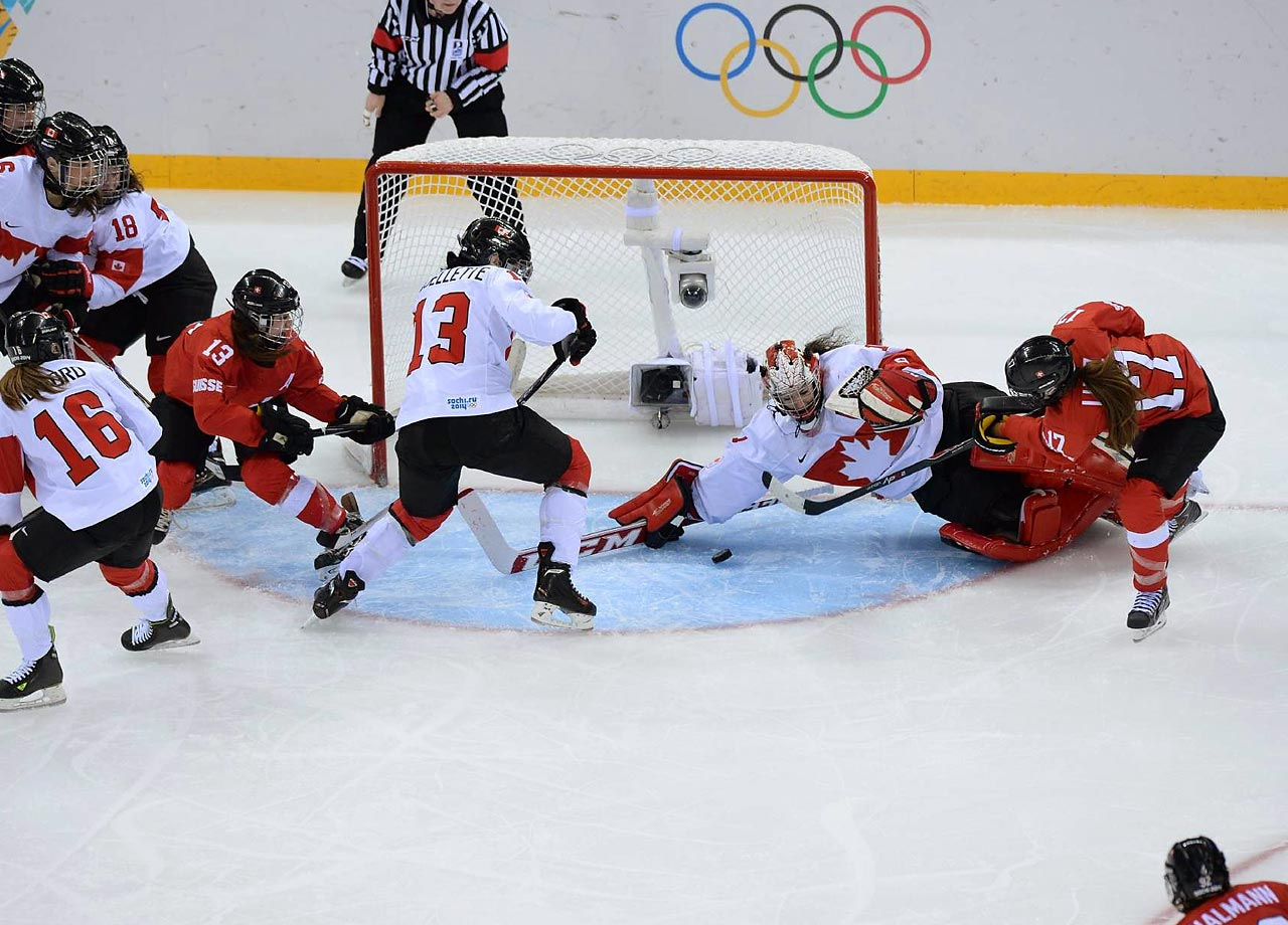 The unbeaten Canadians clinched a spot in the Olympic championship hockey game on Monday for the fifth straight time, beating Switzerland 3-1 in the semifinals.