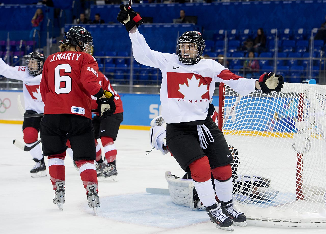 Meghan Agosta celebrates the first of two goals by teammate Natalie Spooner (not pictured).