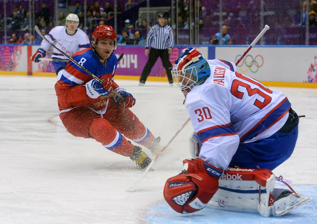 Alexander Ovechkin of Russia showers Norweigen goaltender Lars Haugen with ice during Russia's 4-0 dismantling of Norway in the qualifying round.