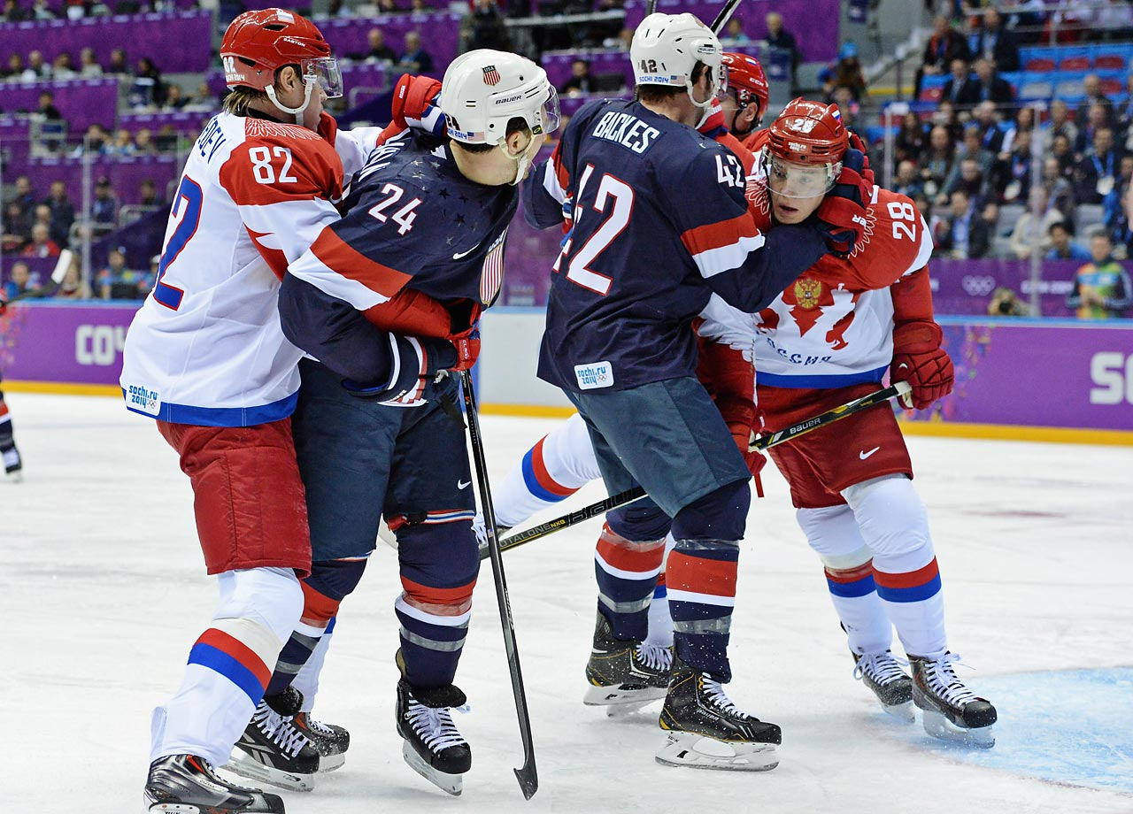 Just a few minutes into the first period, Americans Ryan Callahan and David Backes tussled with Russians Evgeni Medvedev and Alexander Syomin in front of the net, with a glove blow from Backes knocking Syomin's helmet off.