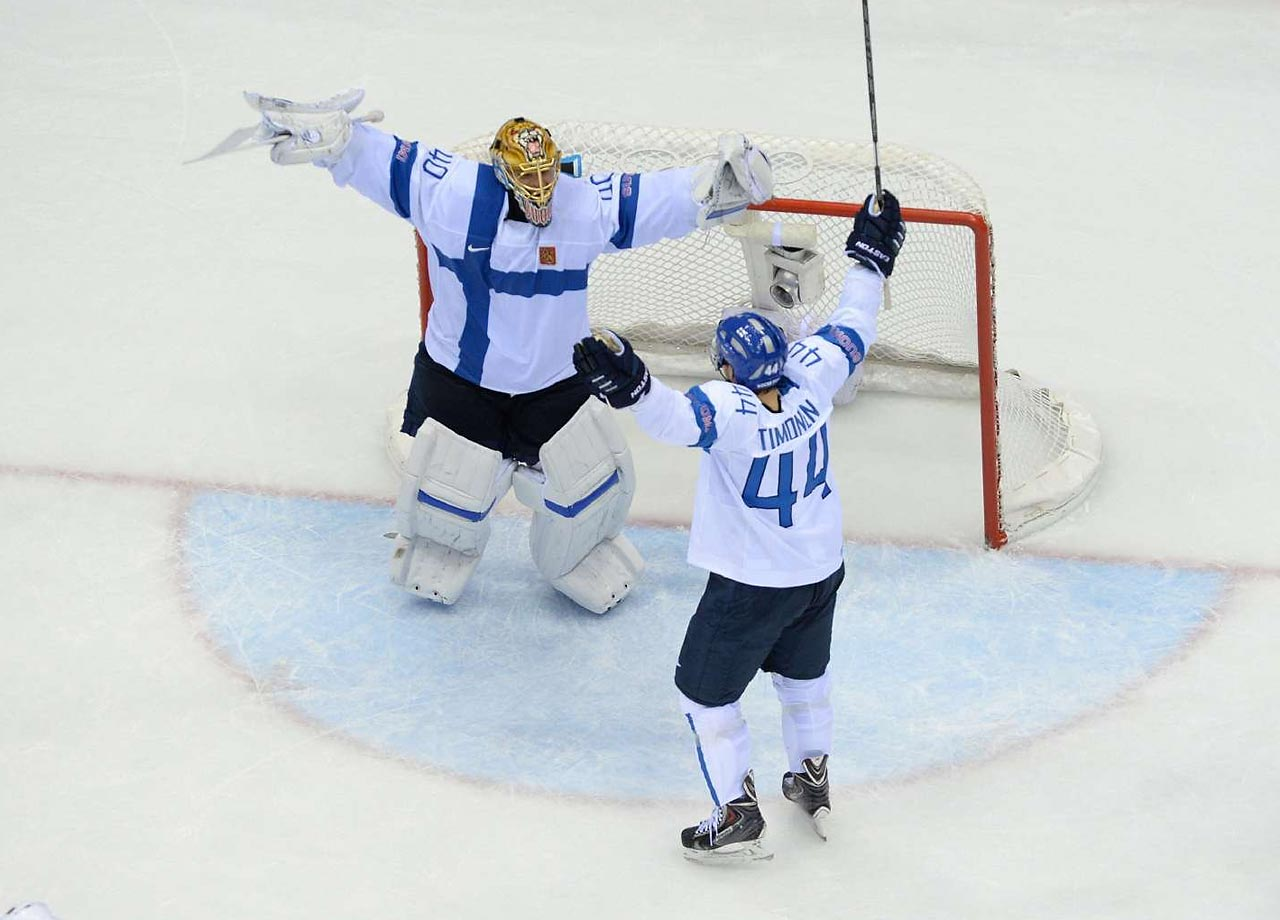 Tuukka Rask and Kimmo Timonen (44) of Finland celebrate their 5-0 victory for the bronze.