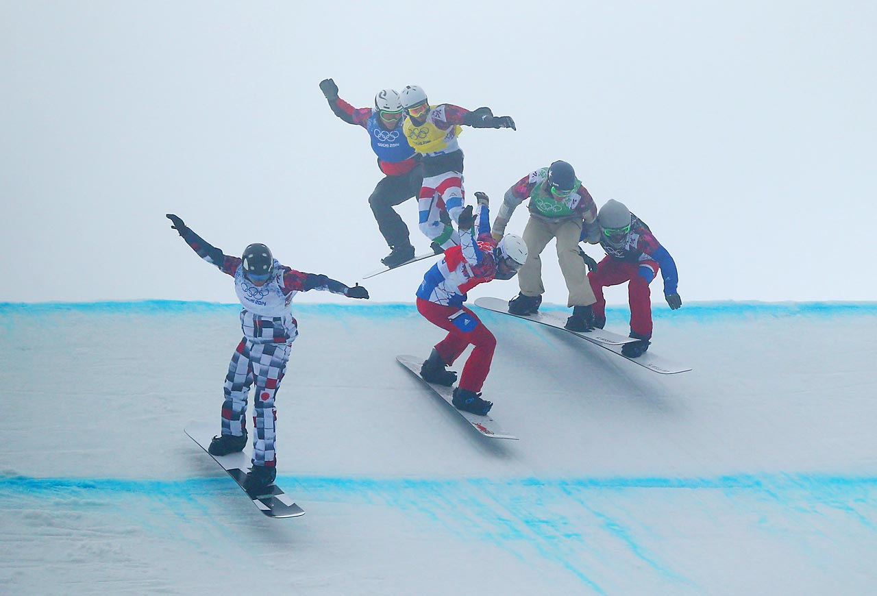 Snowboarders compete in the men's big semifinal of the cross competition.