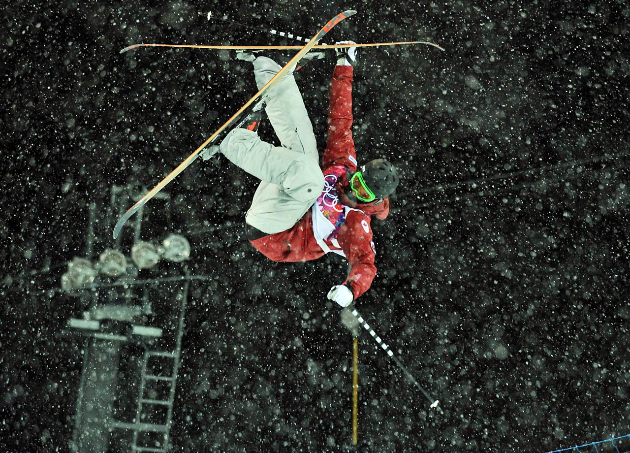 Noah Bowman of Canada flips during qualification for the ski halfpipe event.