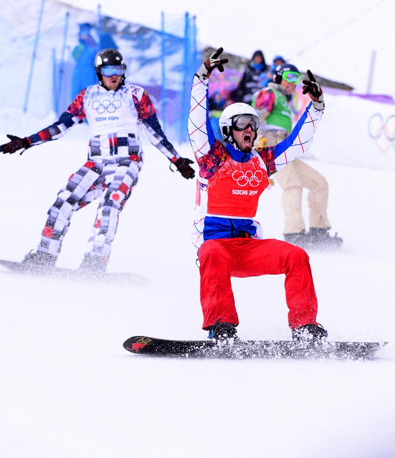 France's Pierre Vaultier claims the gold medal in the men's snowboard cross competition.
