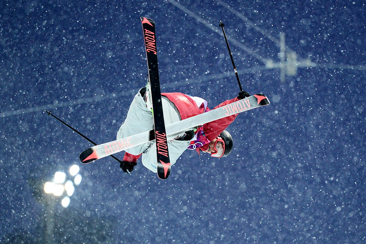 Mike Riddle of Canada looks to land his jump during qualification for the ski halfpipe.