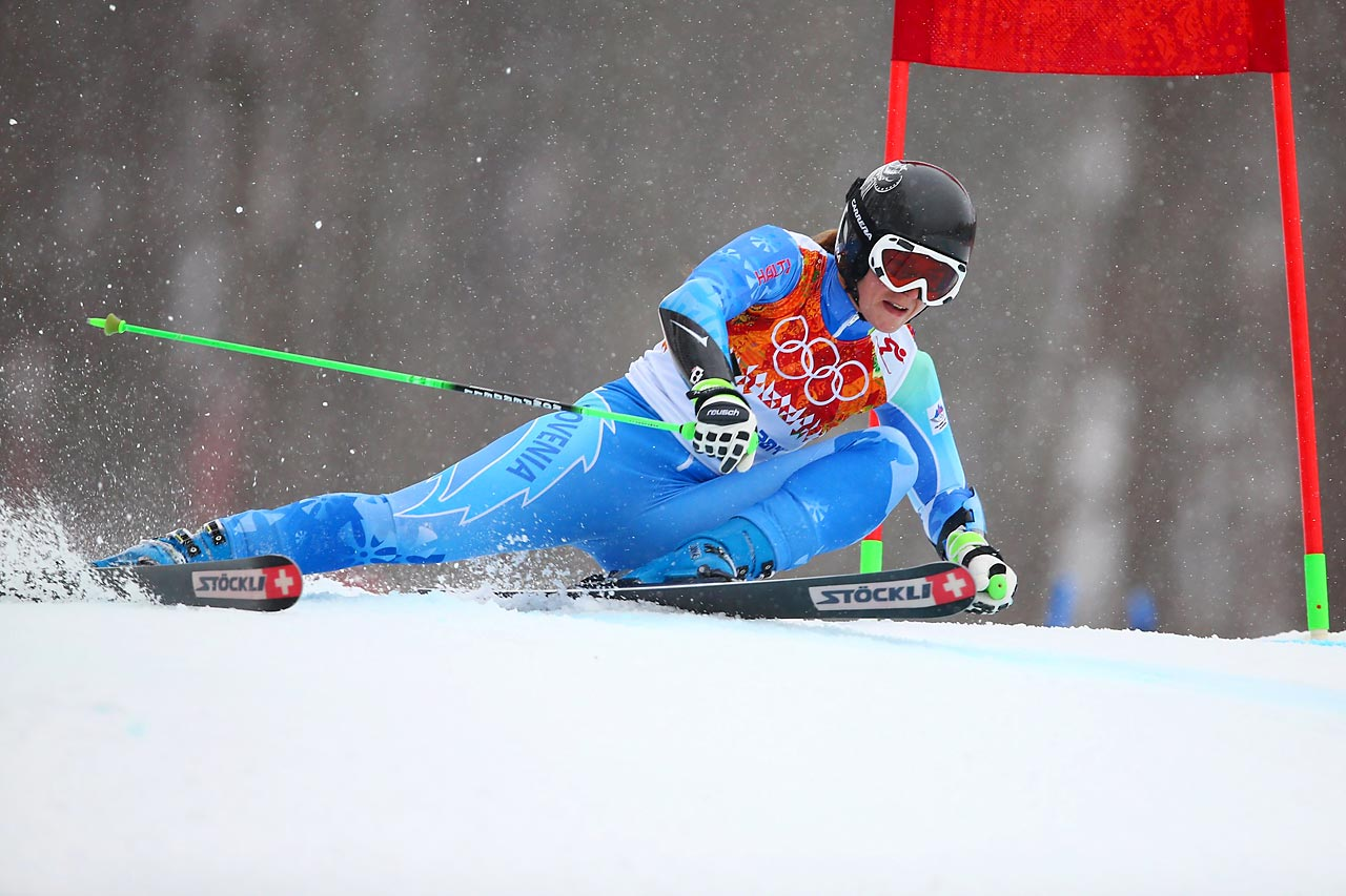 Slovenian skier Tina Maze barrels downhill during the giant slalom. She earned the gold medal for her efforts.