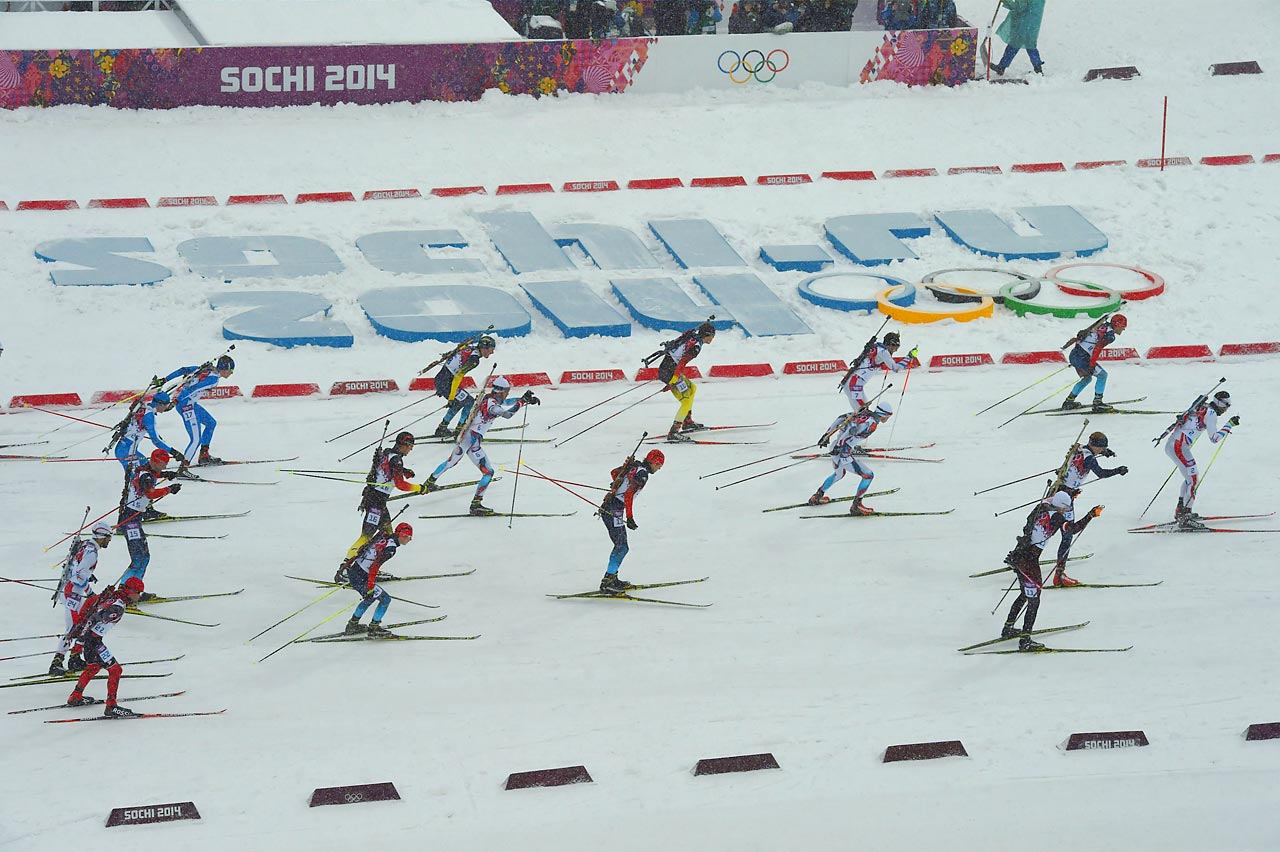 Competitor's in the men's biathlon 15 kilometer mass start race through the course.