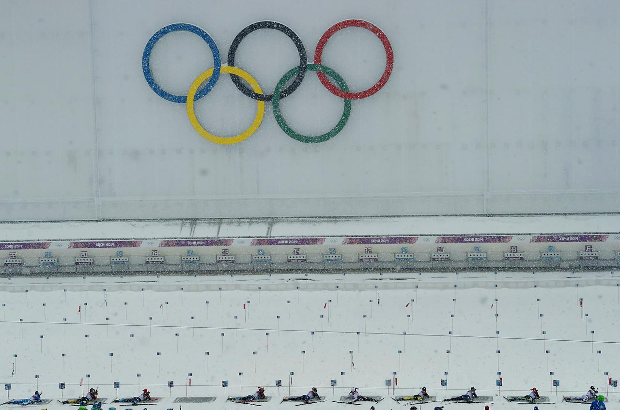 Biathlon competitors shoot during the 15 kilometer mass start competition.