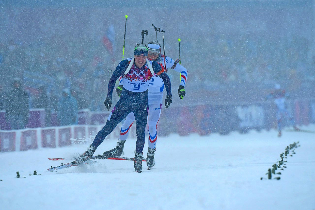 Norway's Emile Hegle Svedsen wins the gold medal in biathlon's 15 kilometer mass start.