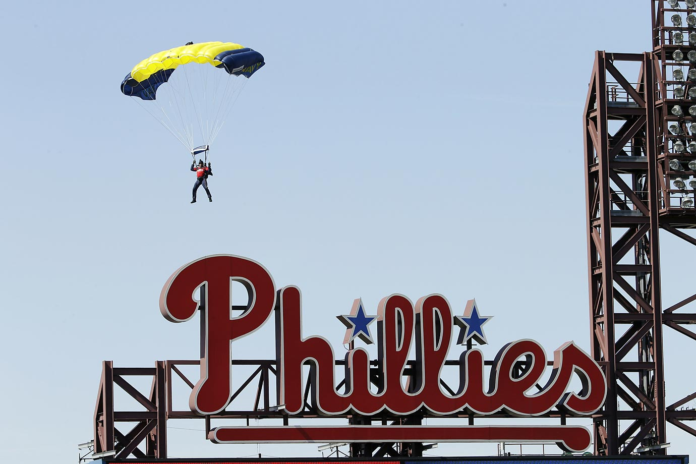 A U.S. Navy parachutist from the Leap Frogs jumps into the Phillies stadium on opening day.