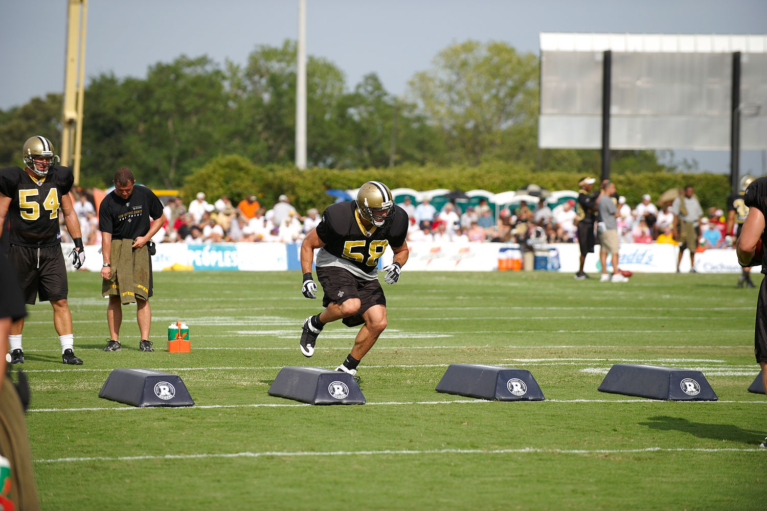 Scott Schanle, of the New Orleans Saints, running agility drills during training camp at Millsaps College in 2008.