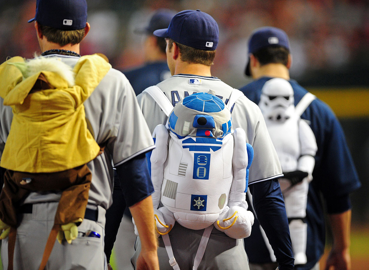 San Diego Padres relief pitchers walk to the bullpen wearing Star Wars themed backpacks prior to the Padres game against the Arizona Diamondbacks on Aug. 28, 2011 at Chase Field in Phoenix.