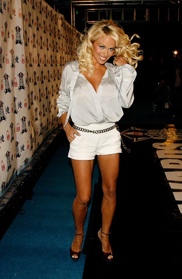 Thursday's PM Hot Clicks: Pam Anderson; Tim Tebow   SI.com