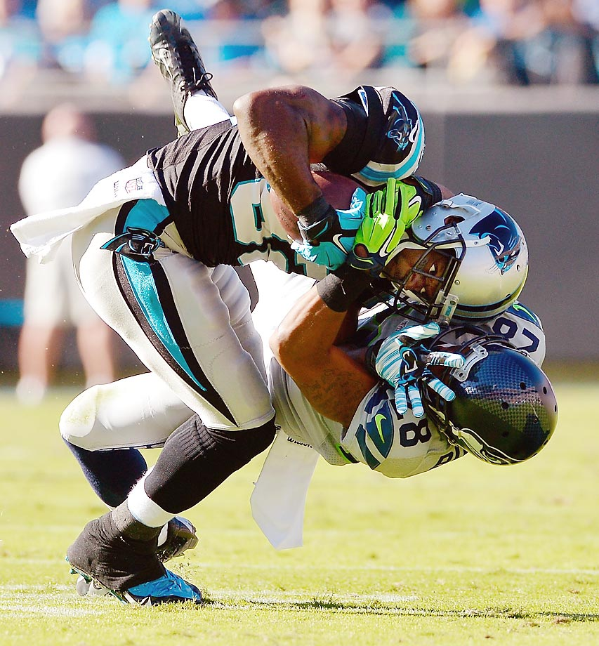 Marcus Burley of the Seahawks tackles Jerricho Cotchery of the Carolina Panthers in a Week 8 game. The Seahawks won 13-9.