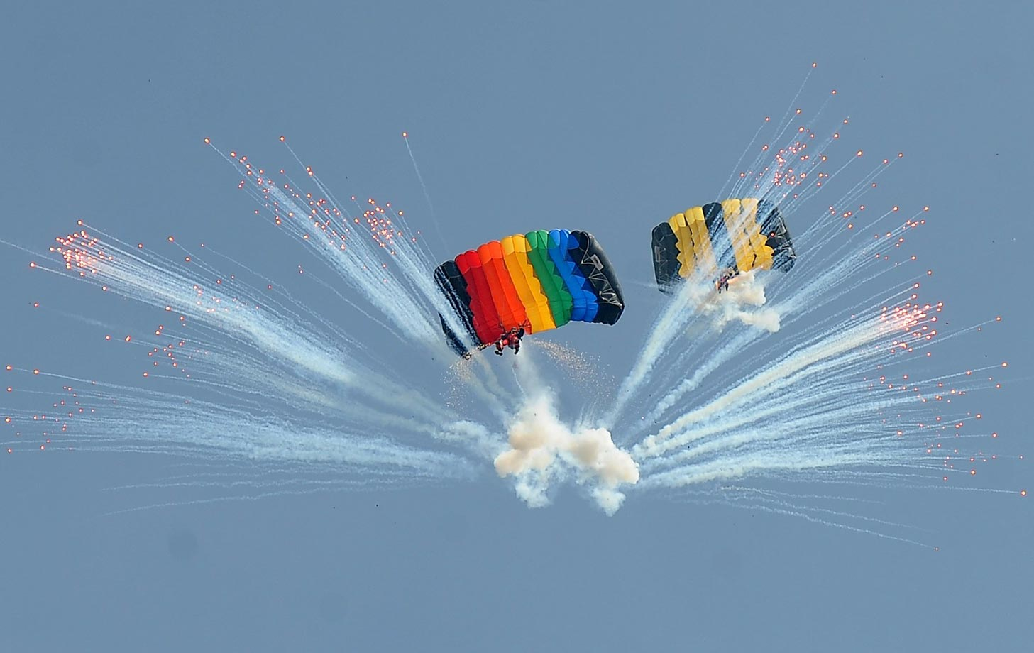 Parachutists perform during the 17th Asia Parachuting Championships in China.