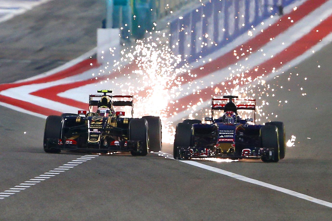 Pastor Maldonado (left) and Lotus and Max Verstappen create sparks during the Bahrain Formula One Grand Prix at Bahrain.