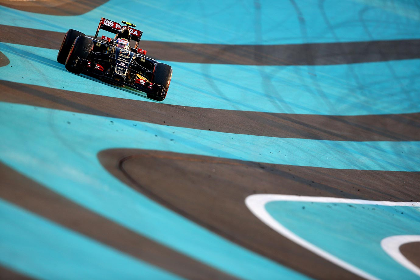 Pastor Maldonado runs wide during the Abu Dhabi Formula One Grand Prix.